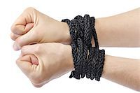 Lady's hands tied in black rope on white backgrou
