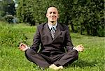 Man businessman meditating outdoors in lotus pose Stock Photo - Royalty-Free, Artist: leedsn                        , Code: 400-06136443