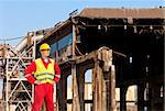 Demolition engineer standing in front of an old factory building, being torn down Stock Photo - Royalty-Free, Artist: corepics                      , Code: 400-06137753