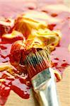 Close up of colorful paint and brush. Focus in the brush Stock Photo - Royalty-Free, Artist: allx                          , Code: 400-06138541