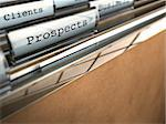 folder with the word prospects and at the backside another one where it is written client, brown paper and clear plastic Stock Photo - Royalty-Free, Artist: olivier26                     , Code: 400-06140343