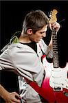 Man with red elegtric guitar, playing solo Stock Photo - Royalty-Free, Artist: leedsn                        , Code: 400-06140856