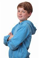 Portrait of a confident young boy on white background Stock Photo - Royalty-Freenull, Code: 400-06141385