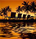 Row deckchairs with water reflection on beach at sunset, Tanjung Aru, Malaysia. Stock Photo - Royalty-Free, Artist: szefei                        , Code: 400-06141579