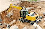 Heavy Yellow Excavator Moving the Stone Stock Photo - Royalty-Free, Artist: jamdesign                     , Code: 400-06142333