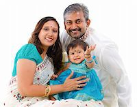 Traditional Indian family with one child sitting on white background Stock Photo - Royalty-Freenull, Code: 400-06142521