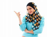 Cute young Muslim woman pointing on empty space, isolated on white Stock Photo - Royalty-Freenull, Code: 400-06142860
