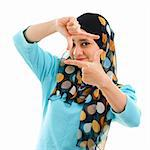 Smiling Asian Muslim woman making a frame with fingers Stock Photo - Royalty-Free, Artist: szefei                        , Code: 400-06142861