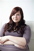fat lady sitting - Portrait of Woman Sitting Stock Photo - Premium Rights-Managednull, Code: 700-06144792