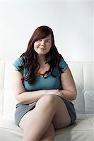 fat lady sitting - Portrait of Woman Sitting on Sofa Stock Photo - Premium Rights-Managednull, Code: 700-06144798
