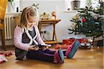 Girl on at Home Opening Christmas Present, Germany Stock Photo - Premium Royalty-Free, Artist: I. Jonsson, Code: 600-06144995