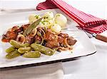 Westphalian Pfefferpotthast (braised beef with vegetables) with salted potatoes and gherkins Stock Photo - Premium Royalty-Free, Artist: foodanddrinkphotos, Code: 659-06151421