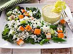 Rice salad with surimi, mange tout and a yogurt dip Stock Photo - Premium Royalty-Freenull, Code: 659-06151513