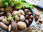 Various nuts in a metal bowl Stock Photo - Premium Royalty-Freenull, Code: 659-06151594