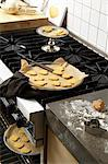 Baked heart biscuits on baking trays in a kitchen Stock Photo - Premium Royalty-Free, Artist: Photocuisine, Code: 659-06151759