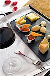 A tray of appitisers (cheese and jam) and a glass of red wine Stock Photo - Premium Royalty-Free, Artist: AWL Images, Code: 659-06151867