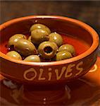 Green olives in a terracotta bowl Stock Photo - Premium Royalty-Free, Artist: CulturaRM, Code: 659-06152152