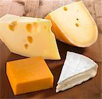 Four pieces of cheese (Emmentaler, Gouda, Cheddar and Brie) Stock Photo - Premium Royalty-Freenull, Code: 659-06152690