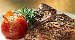 Grilled T-bone steak with tomatoes and rosemary Stock Photo - Premium Royalty-Freenull, Code: 659-06152755
