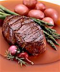 Whole Steak Served with Asparagus and Red Potatoes Stock Photo - Premium Royalty-Free, Artist: Photocuisine, Code: 659-06152842