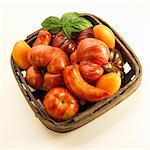 Basket with Heirloom Tomatoes; White Background; From Above Stock Photo - Premium Royalty-Freenull, Code: 659-06152944