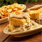 Biscuits with Sausage Gravy; On Rustic Table; Home Fries Stock Photo - Premium Royalty-Free, Artist: AWL Images, Code: 659-06152947
