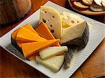 Cheddar, Baby Swiss and Manchego Cheese on a Plate; Crackers Stock Photo - Premium Royalty-Freenull, Code: 659-06152968