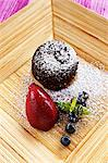 Warm chocolate cake with berry sorbet Stock Photo - Premium Royalty-Free, Artist: Photocuisine, Code: 659-06153001