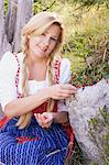 A woman in a dirndl picking lingonberries in a forest Stock Photo - Premium Royalty-Free, Artist: Cultura RM, Code: 659-06153010