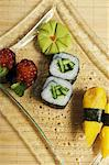 A sushi platter (maki with cucumber and salmon caviar, nigiri with royale) Stock Photo - Premium Royalty-Freenull, Code: 659-06153102