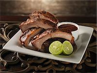 rib - Baby Back Ribs with Lime and Barbecue Sauce Stock Photo - Premium Royalty-Freenull, Code: 659-06153159