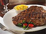 Grilled Porterhouse Steak with a Side of Corn Stock Photo - Premium Royalty-Freenull, Code: 659-06153163