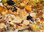 Various types of cheeses, fruit, butter, quail's eggs and autumnal leaves Stock Photo - Premium Royalty-Freenull, Code: 659-06153266