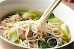 Hand Twirling Noodles from Shanghai Noodle Meatball Soup onto Chopsticks Stock Photo - Premium Royalty-Freenull, Code: 659-06153844