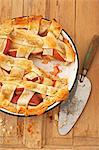 Apple Lattice Crust Pie with Slice Removed; On Wooden Surface with Knife; From Above Stock Photo - Premium Royalty-Free, Artist: Photocuisine, Code: 659-06154042
