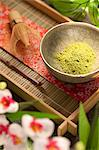 Japanese Matcha Green Tea Powder in a Bowl on Tray; Flowers Stock Photo - Premium Royalty-Free, Artist: Blend Images, Code: 659-06154192