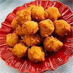 Hush Puppies on a Red Plate Stock Photo - Premium Royalty-Freenull, Code: 659-06154201