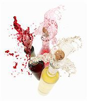 Wine spraying out of bottles (red wine, rose wine and white wine) Stock Photo - Premium Royalty-Freenull, Code: 659-06154371