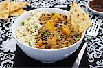 Pumpkin curry with lentils, beans and naan bread (India) Stock Photo - Premium Royalty-Free, Artist: Science Faction, Code: 659-06154381