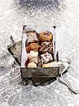 Various Christmas biscuits in a biscuit tin Stock Photo - Premium Royalty-Freenull, Code: 659-06154804