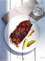 rib - Spare ribs with gherkins and a glass of water (seen from above) Stock Photo - Premium Royalty-Freenull, Code: 659-06154809