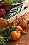 Organic Golden Beets Next to a Basket Filled with Red Beets and Leeks Stock Photo - Premium Royalty-Free, Artist: CulturaRM, Code: 659-06154915
