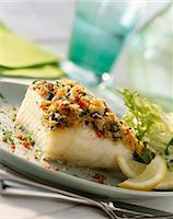 Sea bass fillet with a herb and garlic crust Stock Photo - Premium Royalty-Freenull, Code: 659-06155231