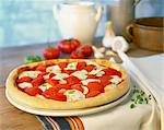 Tomato and mozzarella pizza Stock Photo - Premium Royalty-Freenull, Code: 659-06155296