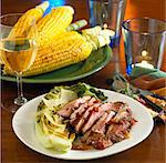 Sliced Grilled Duck Breast with Romain; White Wine and Corn on the Cobb Stock Photo - Premium Royalty-Freenull, Code: 659-06155542