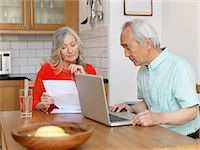 Older couple paying bills online Stock Photo - Premium Royalty-Freenull, Code: 649-