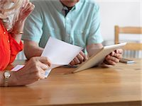 Older couple reading mail in kitchen Stock Photo - Premium Royalty-Freenull, Code: 649-06164539