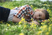 preteen beauty - Woman laying in field of flowers Stock Photo - Premium Royalty-Freenull, Code: 649-06164767