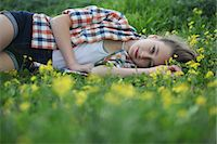 preteen beauty - Woman laying in field of flowers Stock Photo - Premium Royalty-Freenull, Code: 649-06164768