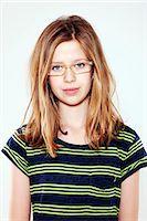 preteen beauty - Smiling girl wearing glasses Stock Photo - Premium Royalty-Freenull, Code: 649-06164832